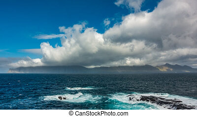Spectacular turning clouds over islands time lapse - ...