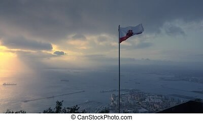 Spectacular view from the Rock of Gibraltar to waving flag...