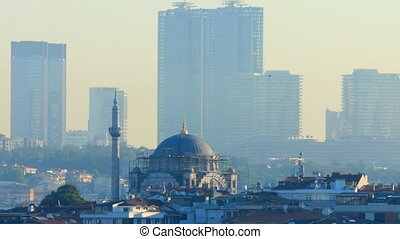 Mosque in Istanbul with skyscrapers in the background