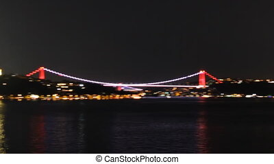 Istanbul's bridge and coastline at night