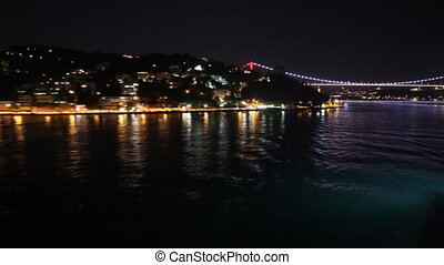 Istanbul's bridge and hills at night