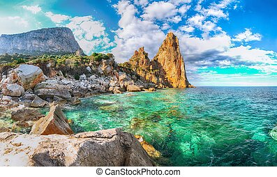 Spectacular view of Punta Pedra Longa and azure water in sea. Location: Baunei, Province of Nuoro, Sardinia, Italy, Europe