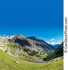 Spectacular view of Stelvio pass curves under blue sky - ...