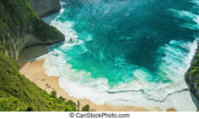 Spectacular waves rampage in the Manta Bay or Kelingking Beach with blue crystal water, Nusa Penida Island, Bali, Indonesia