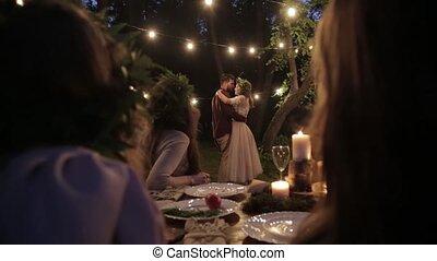 Spectators admire newlyweds - Bride groom dance slow dance...