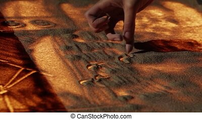 Spectators - Drawing with sand. The crowd of listeners at a...