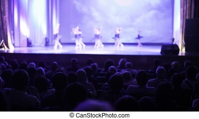 Spectators watch performance of graceful ballet dance in...