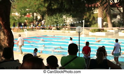 Spectators watching competitive - Spectators watching...
