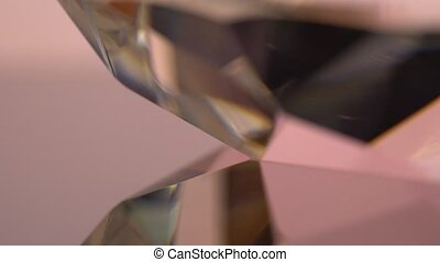 Specular reflection of the thick edge of the diamond in pink...