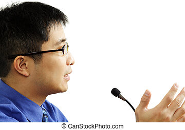 A businessman giving a speech (isolated white)