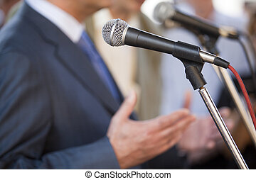 speech - Microphone where a speaker is about to make his...