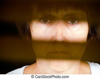 Speechless. Disempowered woman behind barrier. Femal...