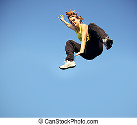 Speed And Agility In Parkour - A woman traceur dropping from...