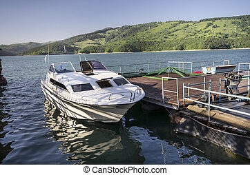 Speed boat at dock - Speed boat at the docks on Bicaz Lake,...