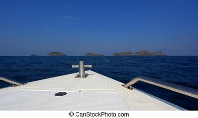 Speed boat floating to the islands in ocean - Speed boat to...