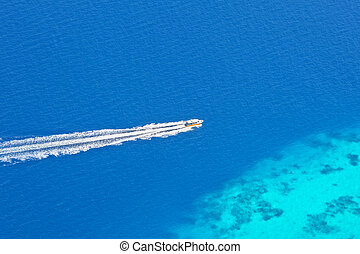 Speed boat from aerial view, Maldives - Speed boat from...