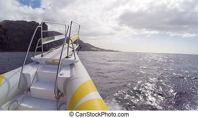 speed boat going fast by the shore at Tenerife