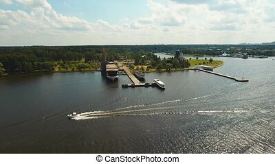 Small luxurious yacht. Fast moving speed boat floating on the lake. Aerial footage, 4k.