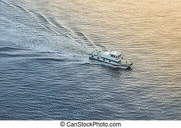 Speed boat on the sea at sunset time.