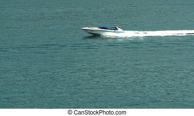 Speed Boat Passes By - Steady, medium wide shot of a boat...