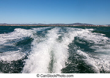 speed boat waves