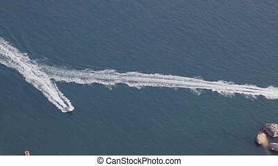 Speed boats racing in the sea