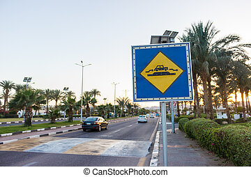 Speed Bump sign on the sunny road in Egypt