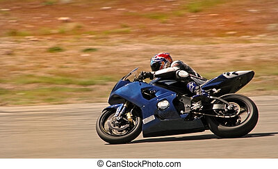 Speed Demon - Motorcycle rider races by.