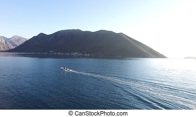 Speed Dinghy at high speed sailing on the sea. Kotor Bay