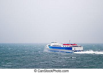 Speed Ferry on Ocean - A speed ferry catamaran on the Ocean