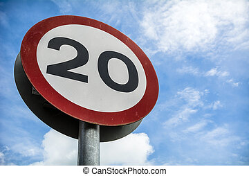 Speed limit - Road sign against sky showing a low speed ...