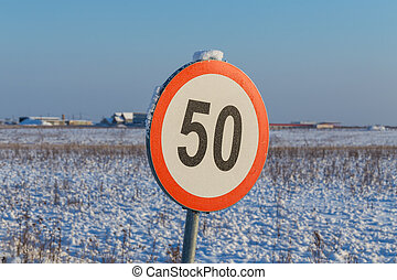 Speed limit sign 50 during winter