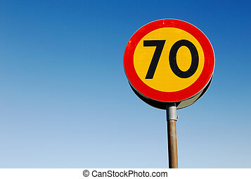 Speed limit sign 70 - One speed linit sign 70 kmh against a...