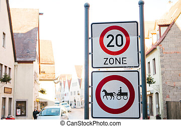 Speed limit sign and horse traffic sign on a street. - Speed...