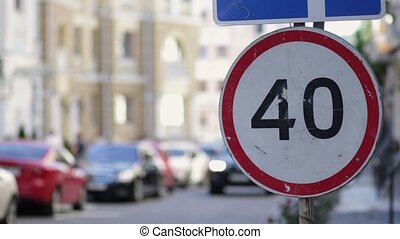 Speed limit sign in the city street on summer day
