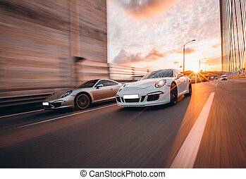 Speed motion between two sport cars in the tunnel