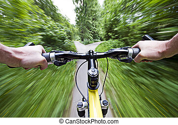 Speed - Mountain biking down hill descending fast close up