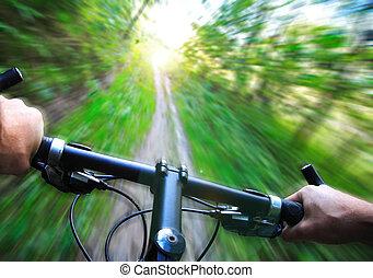 Mountain bike speed zoom motion blur. Fast downhill biking.