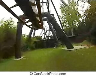Speed rides, amusement park. Screams of frightened tourists...