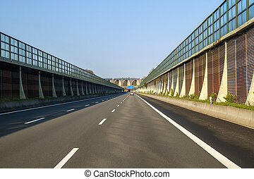 Speed road freeway in Germany with high walls on the sides