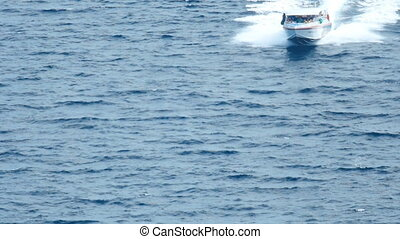 Speedboat approaches the beach Similan Islands - Speedboat...