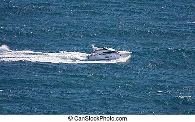 speedboat cruising in sea