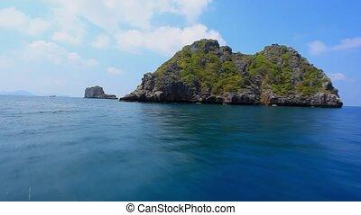 speedboat floats between the islands in ocean - speedboat...