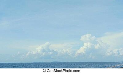Speedboat ocean trip - Seascape with cumulus clouds high...