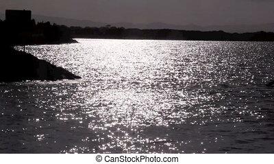 Speedboat On Sparkling Water - Speedboat passes through...