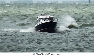 Speedboat on the waves comming into the harbour.