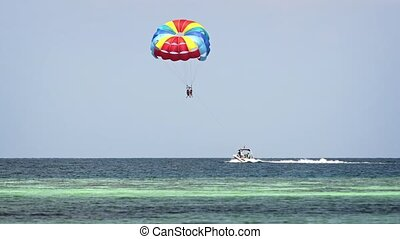 Speedboat Towing Parasail off Maafushi Island in the...