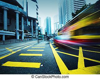 Speeding bus, blurred motion. - Bus speeding through night...