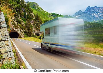 Speeding Camper on a Mountain Road. Class C Recreational...