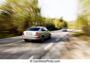 Speeding Car - A motion blur image of a speeding car